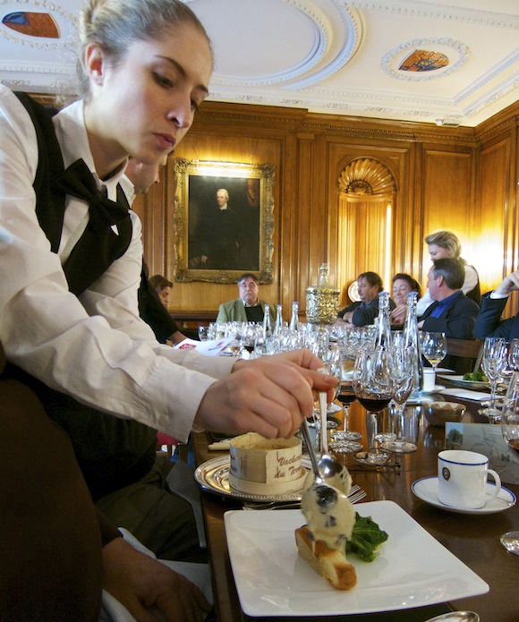 Waitress serving Vacherin and truffles at a lunch organised by The Wine Society