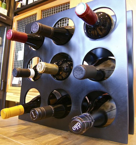 BLACK BRUSHED ALUMINIUM WINE RACK WITH BOTTLES