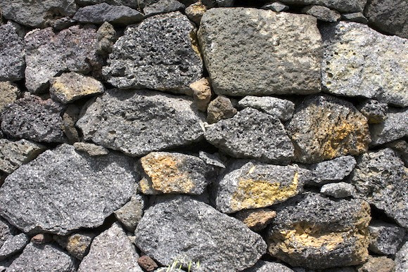 Lava stones in a terrace in a vineyard owned by Nicosia in Etna