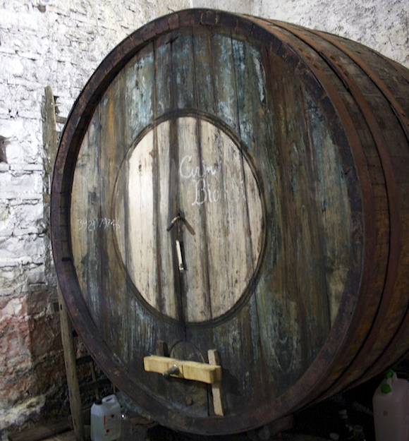 An old barrel in the cantina at Vini Biondi, Etna, Sicily