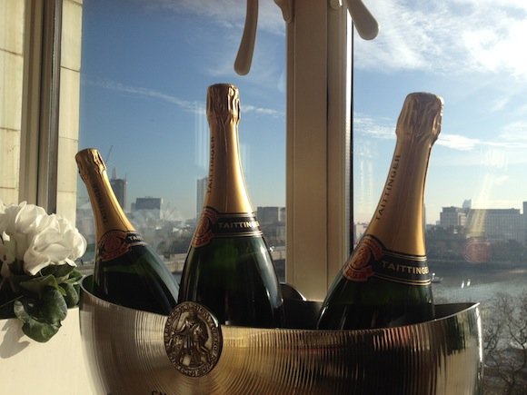 Bottles of Taittinger Champagne in an ice bucket against a window at the Savoy overlooking the Thams