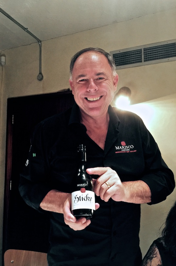 Brent Marris of Marisco holding a bottle of dessert wine