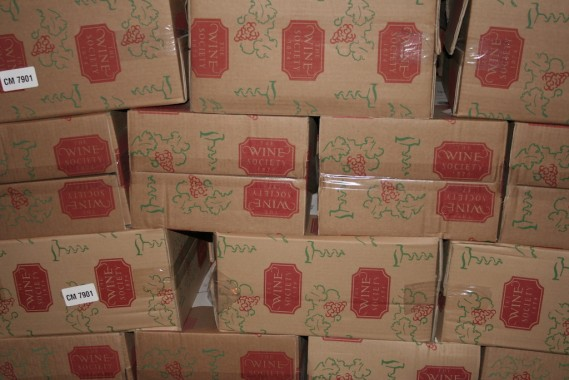 Boxes branded with 'The Wine Society'