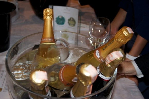 Bottles of Franciacorta Italian sparkling wine in a bowl