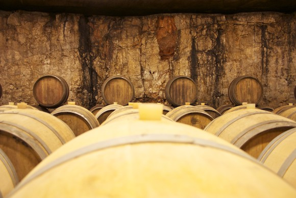 Barrels of wine in Kante's subterranean cellar in the Carso, Friuli, Italy