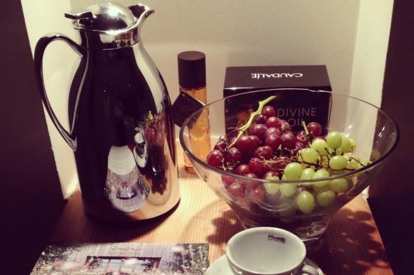 grapes, tea pot, cup at the Caudalie spa