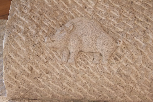 A boar carved into a limestone pillar at Zidarich winery in the Carso, Friuli, Italy